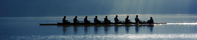 rowing team in their boat on the water